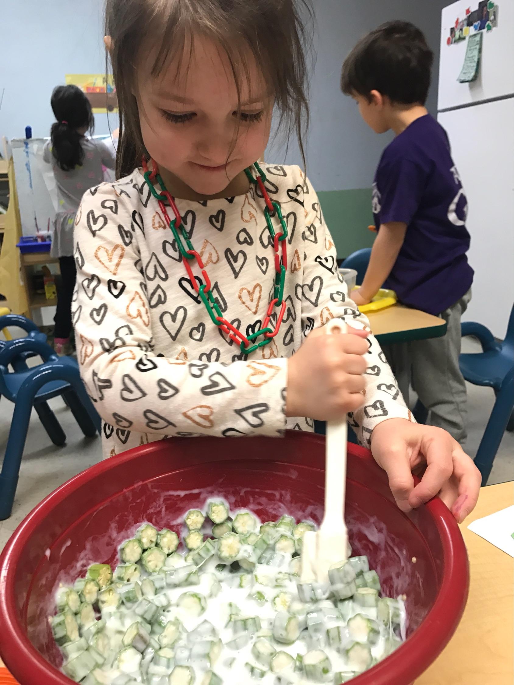 Charlie Kate prepares fried okra