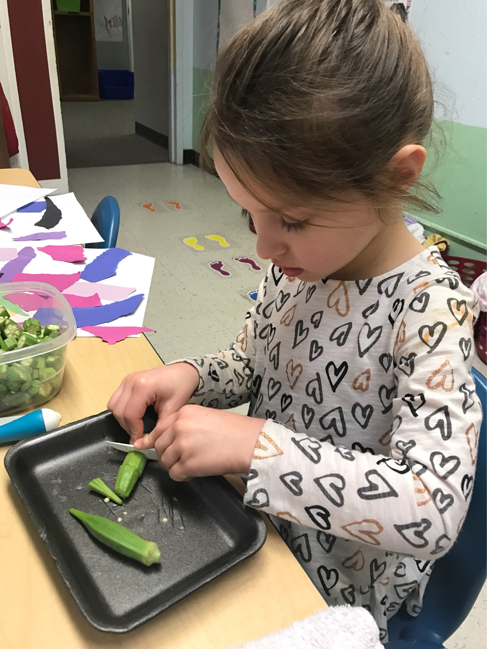 Charlie Kate cuts okra